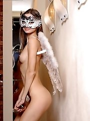 An Alluring Blonde With Angels Wings On Her Back And A Mask On Her Cute Face Posing Naked In Her Apa