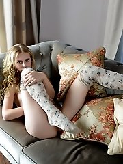 Curly Haired Brunette Beauty Spreads Her Long Sexy Legs To Show Some Of Her Juicy Little Cunt And Ho