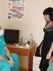 Naked brunette goes thru a med examination