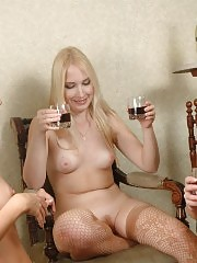 Sexy girls sitting around naked drinking
