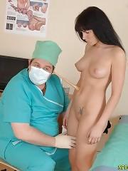 Naked brunette goes thru a med examination