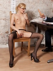 Undressed to pantyhose and sucking an interview dildo