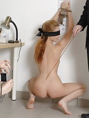 Blindfold and speculum-examining her own business pussy