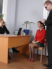 Undressing woman before a fetish job exam