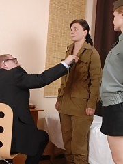 Doctors tyrannize a coy female soldier