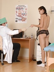 Naked gal passes thru a dizzy gyno exam