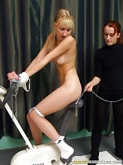 Nude gymnast gets chained to exercise bike