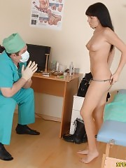 Slim brunette examined by a male physician