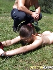 Muscled kink strips his sexy trainee outdoors