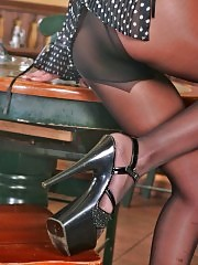 Long legs, black pantyhose and exotic platforms