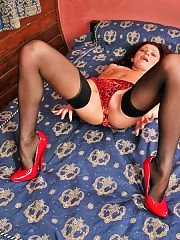 Jenny spreads her legs in fashion stockings & pumps!