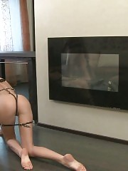 Sport mistress uses a dildo flogger in training