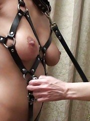 Mistress makes a harnessed gymnast do impossible things