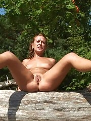 Extreme naked exercises with dumbbells outdoors