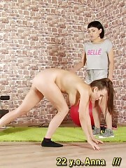 Petite trainer breaking a tall busty gymnast