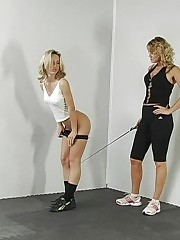 Gym mistress bends a gymnast to her will