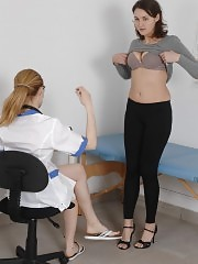 Two examiners humiliate a nude medical fetish girl