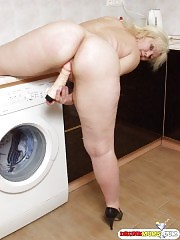 Hot blonde mom plays with her dildo