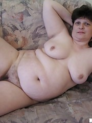 Nude fat housewife playing with unshaved pussy
