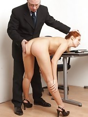 Boss OTK spanking a red-haired office slut