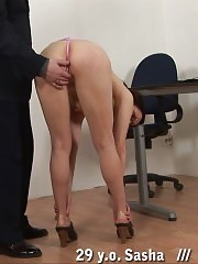 Office disciplining of a girl with ponytails