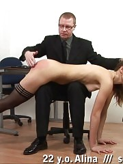 Boss with a flogger and a paddle and his secretary