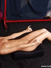 Nude blonde working out her belly muscle