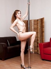Amateur stripper with long hair exercises at home