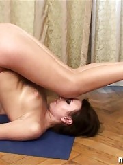 Nude dancing and yoga by a busty flexible babe