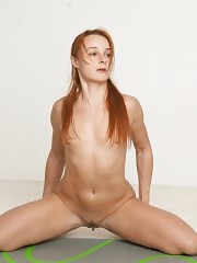 Yoga gymnast with red hair and small titties