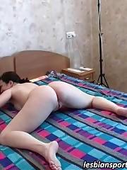Two lesbian gymnasts filming their hot training