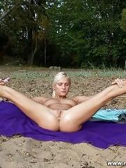 Little flexible gymnast posing nude outdoors