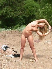 Lissome blondie does beach nude exercises