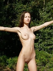 Nude aerobics on a quiet forest glade