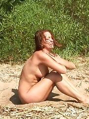 Hot naked gymnastics on the sunny beach