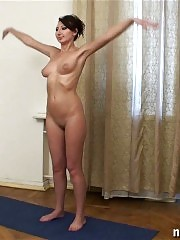 Big-titted sport girl dances and stretches on the floor