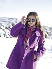Delicious long haired shapely teen honey showing off her perfect body outdoor on the snow.