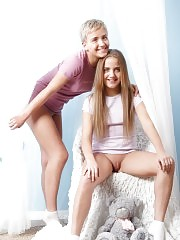Two marvelous shapely lesbian teen chicks undressing and posing together just in white socks.