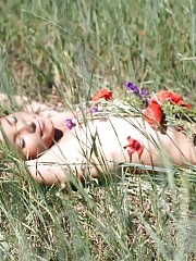 Sunny weather and green field with lots of different flowers is the most pleasant and suitable place for this cheeky nude teen to entertain.