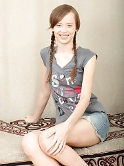 Wonderful teen cutie with two long braids hardcored in shaved pussy and creamed on bed.