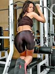 Sporty lass posing in tight gym shorts