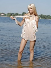 Awesome extreme teen is standing in the river fully nude and massages her fascinating humps till complete satisfaction.