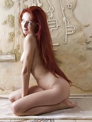 Amazing beauty with splendid long red hair and flawless boobs strips and poses in the nude.