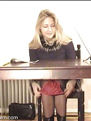 Hot blonde secretary masturbating under the table