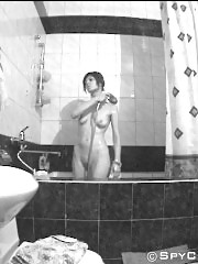 Sexy chick takes a shower unsuspecting of spying