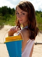 Petite Brunette Gets Naked On The Beach And Plays With The Sand And Her Amazing Body That Shines Bri